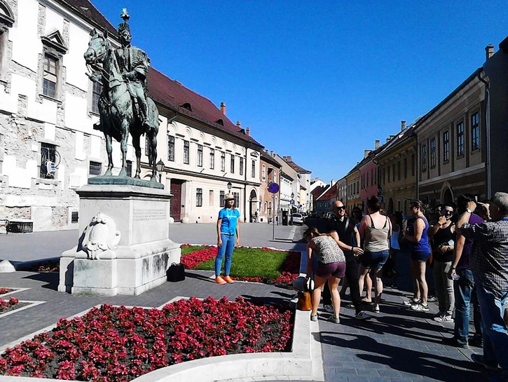 Guide taking people on walking tour of Budapest