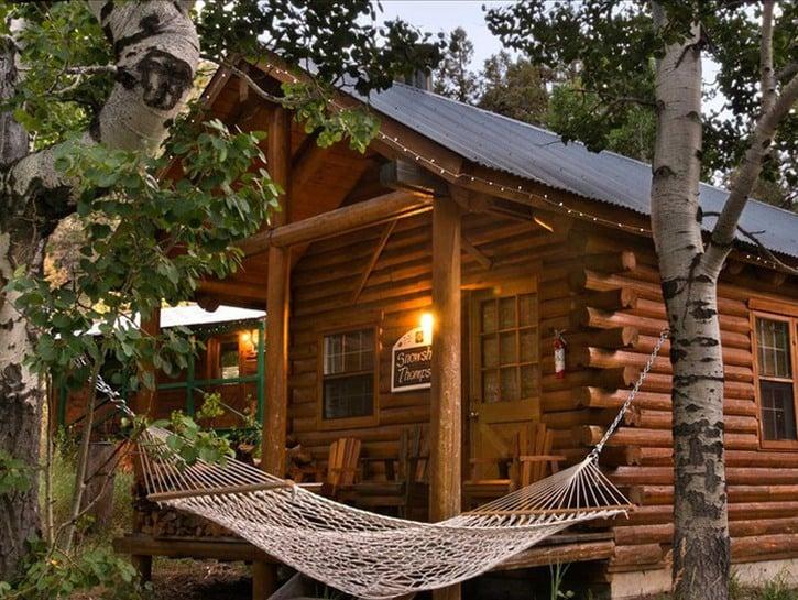 Hammock in front of log cabin cottage