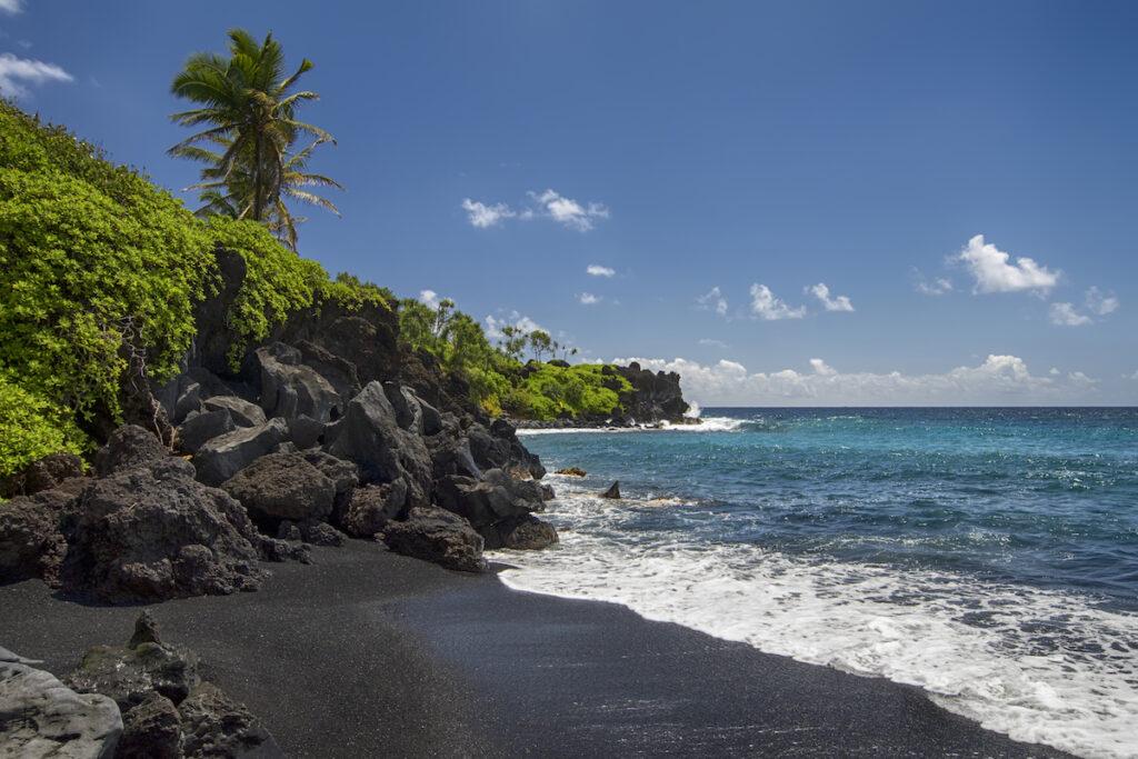 Hana Black Sand Beach on the coast of Maui.