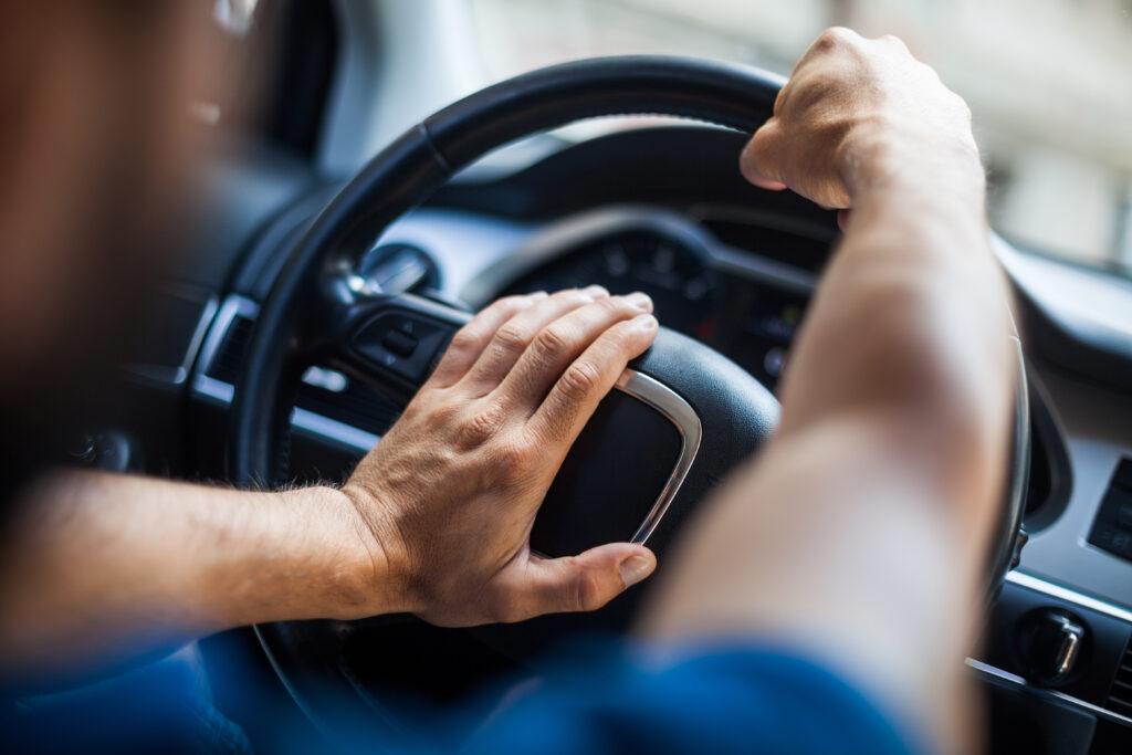 Hand honking a horn