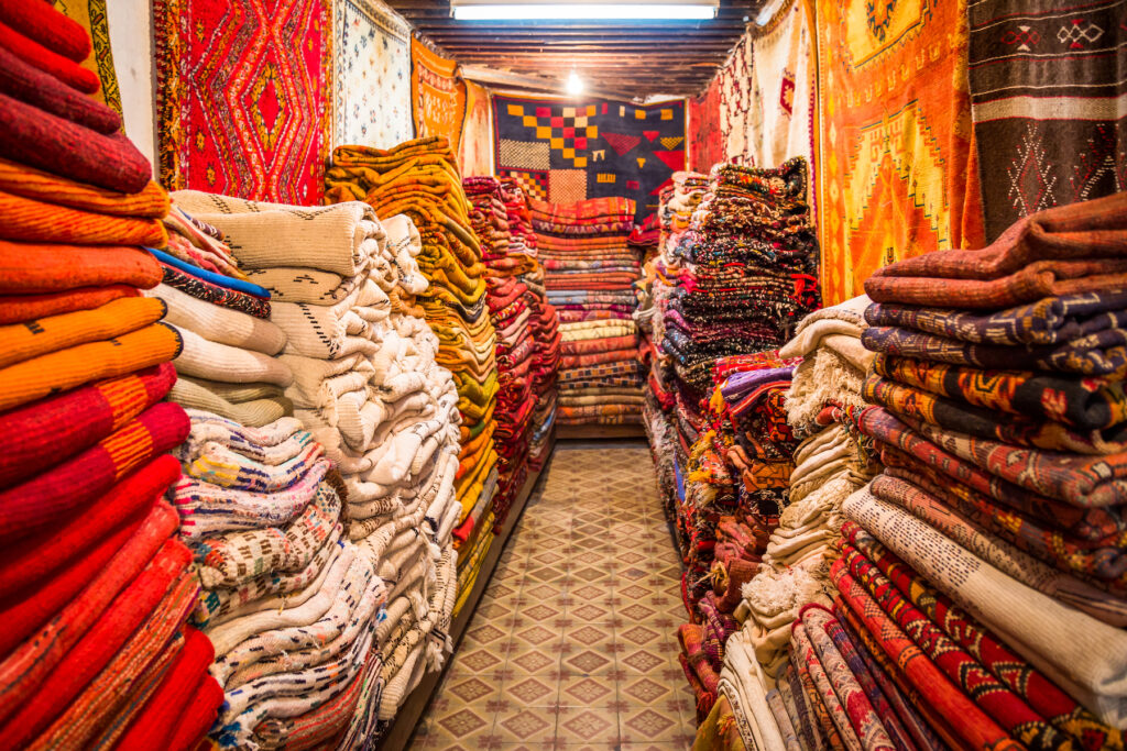 Hand-woven Moroccan carpets at a shop in the medina of Fes.