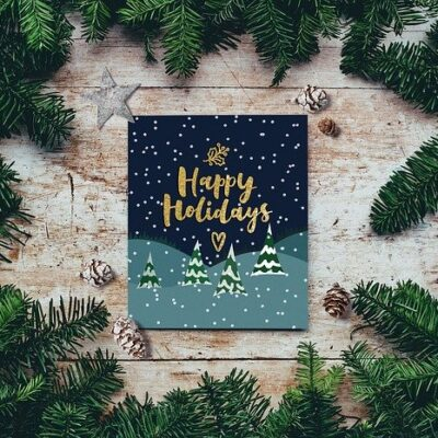 Happy Holidays card surrounds by Christmas garland