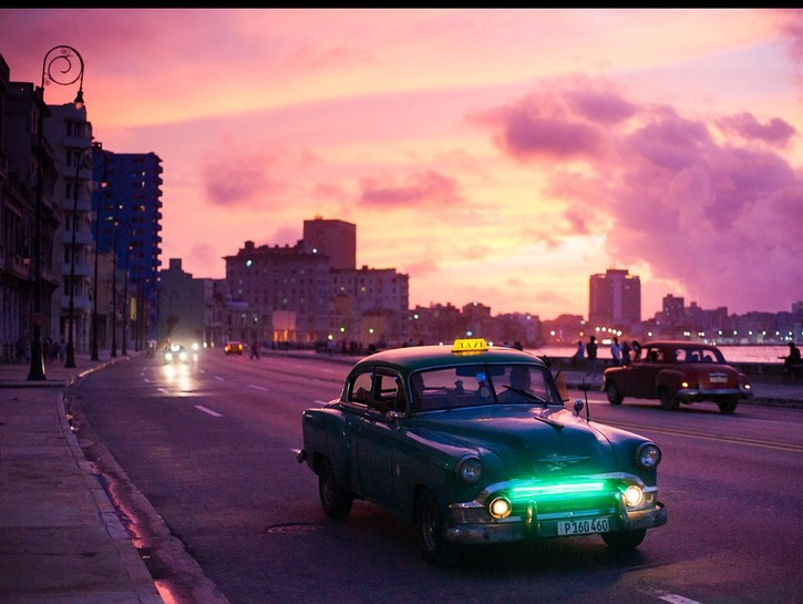 Havana at sunset, with a green taxi.