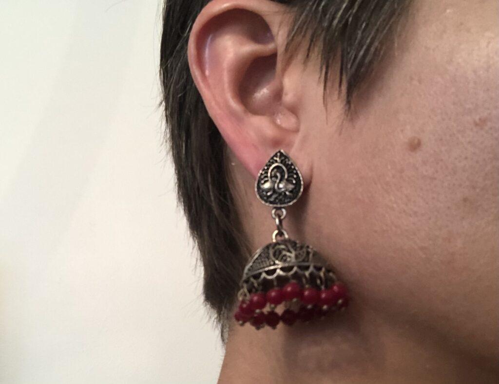 Heavy earrings from India.