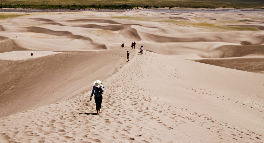 Hikers in Great Sand Dunes National Park.