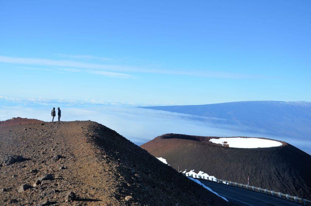 Hikers on the summit of Mauna Kea in Hawaii.