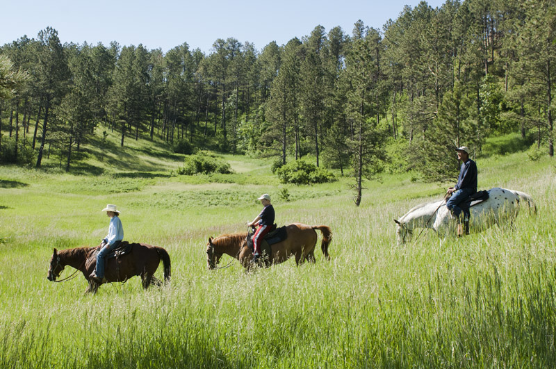 Horseback riding in Chadron State Park, Nebraska.