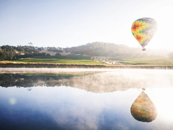 Hot air balloon over Napa river, foggy morning
