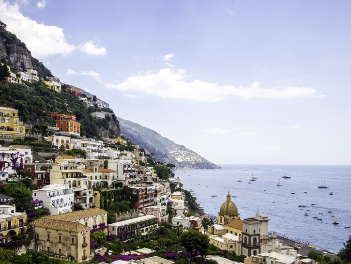 Houses of Positano Italy, boats in the harbor