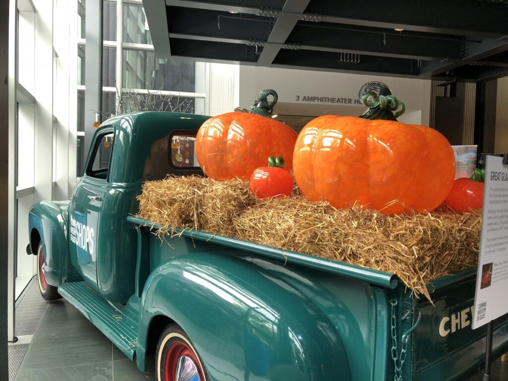 Huge glass pumpkins at the entrance to the Corning Museum of Glass.