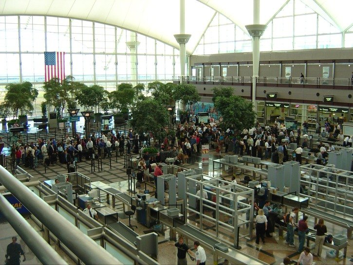 Huge line of people waiting for airport security.