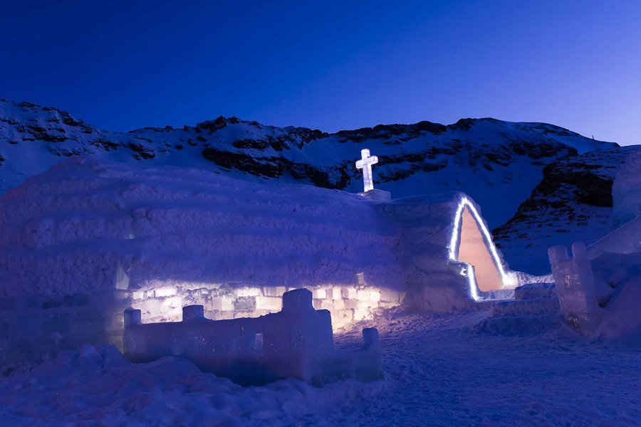 Ice church with mountains in the back