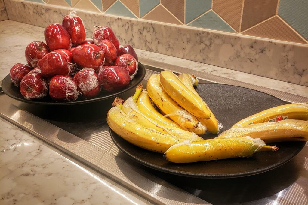Individually wrapped apples and bananas.