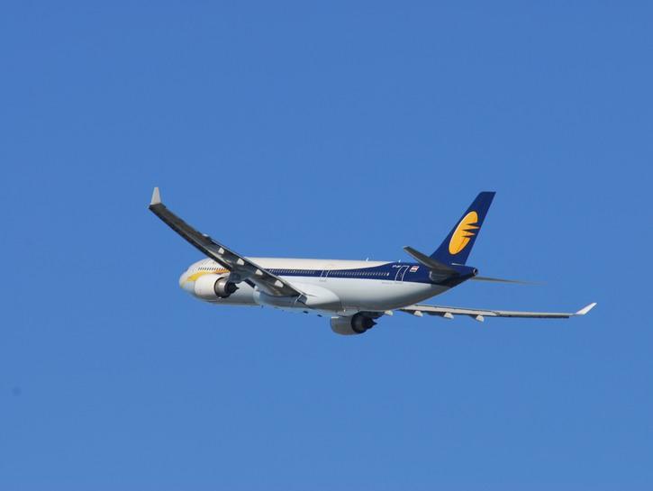 Jet Airways two-engine plane in flight.
