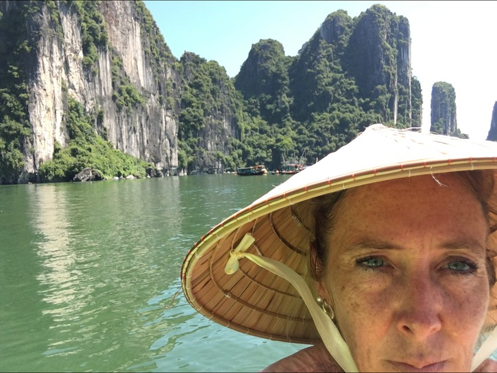 Juliann Wetz on the river wearing rice hat