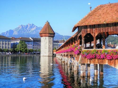 Kapellbrücke bridge, Lucerne, Switzerland, with flowers hanging on the bridge