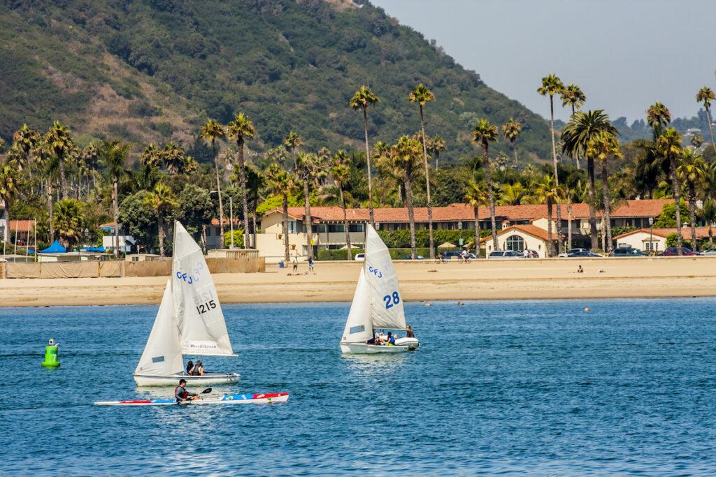 Kayakers and sailboats in Santa Barbara.