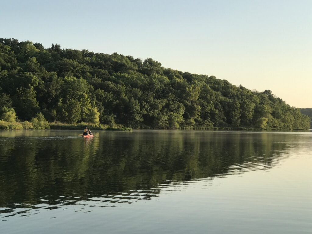 Kayakers on a lake during the summer.