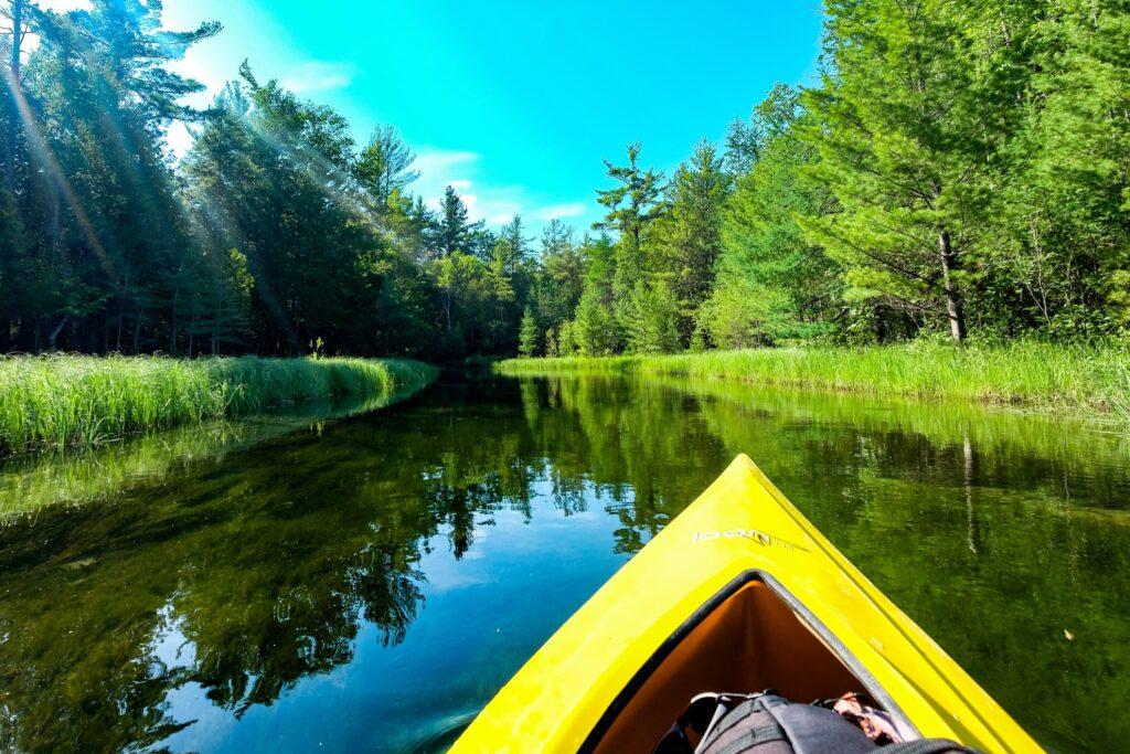 Kayaking down the Crystal River in Michigan.