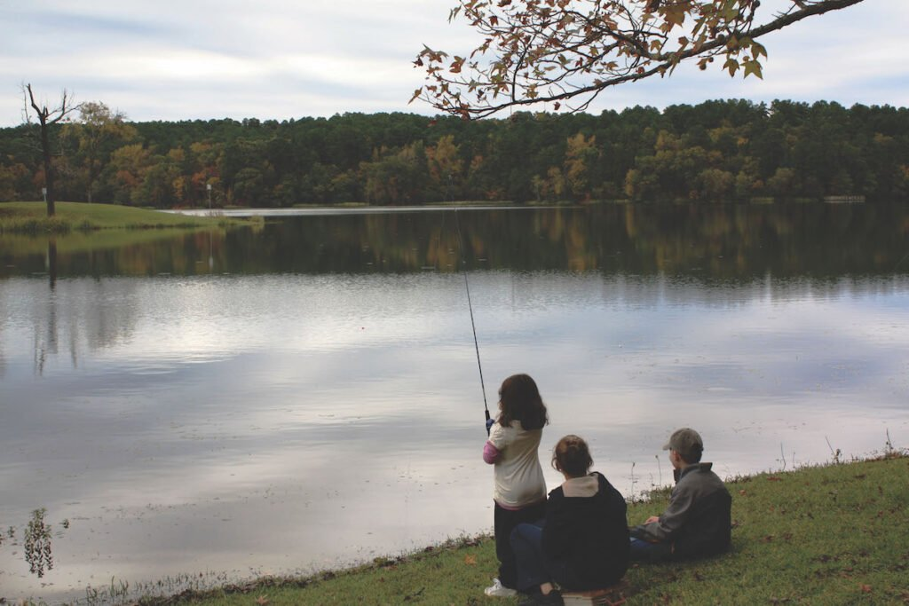 Kids fishing at Tyler State Park in Texas.