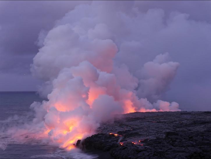 Kilauea's lava dripping into the ocean, steam rising, Hawaii