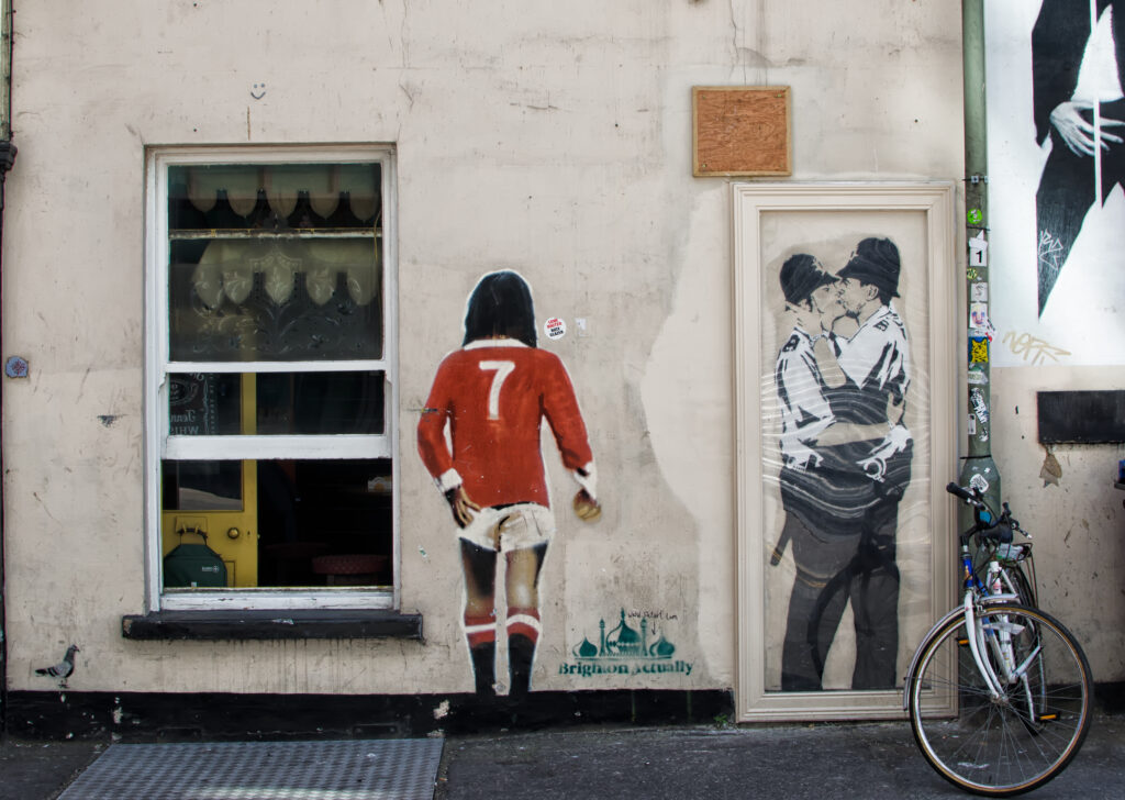 Kissing Coppers, a soccer player, and other graffiti in Brighton, UK