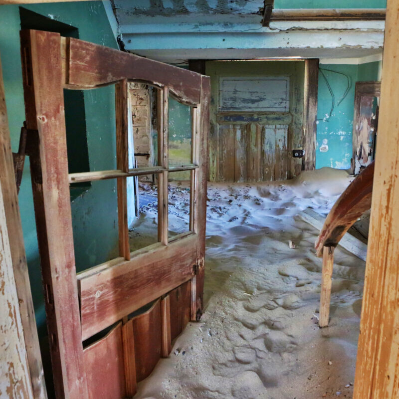Kolmanskop, Namibia, a ghost town being swallowed by the desert.
