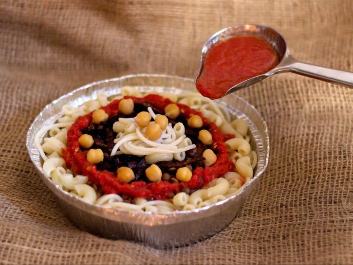 Koshari with tomato sauce on top
