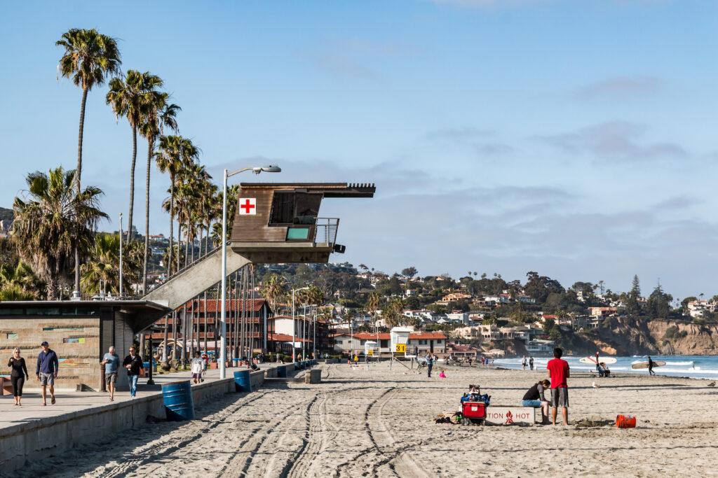 Lifeguards and beachgoers enjoying La Jolla Shores.