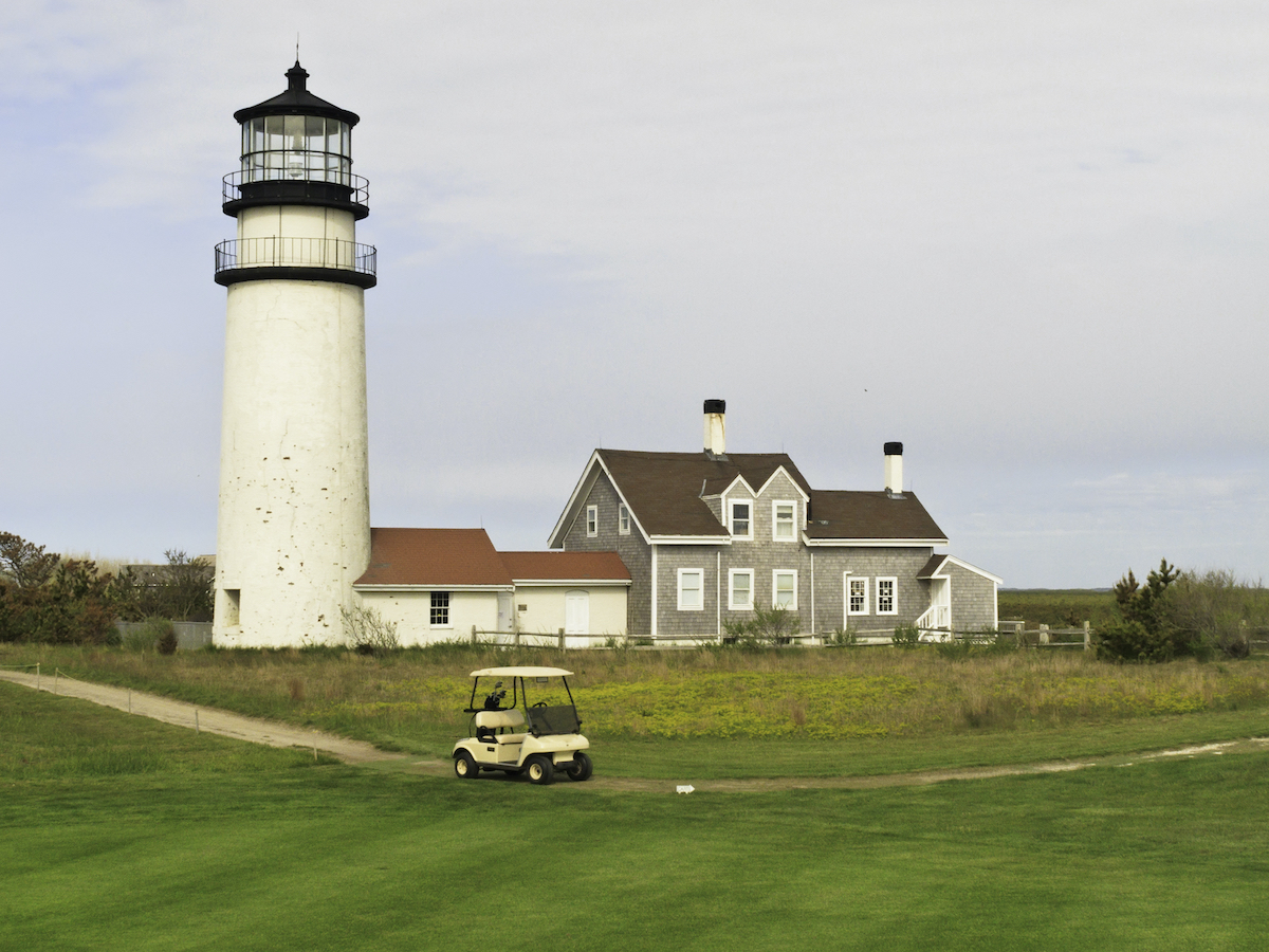 Lighthouse and golf cart in Cape Cod.