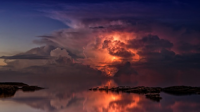 Lighting in storm clouds over water