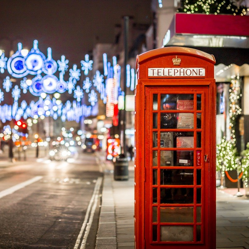 London phone booth with Christmas lights in background