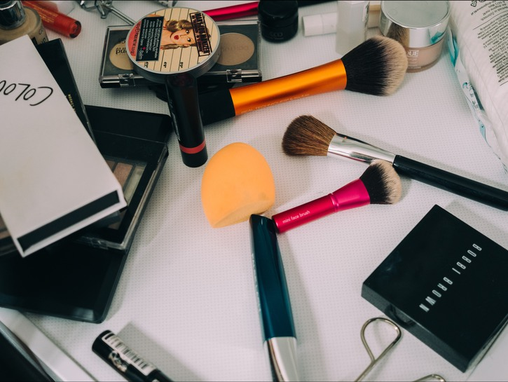 makeup products laid out on table