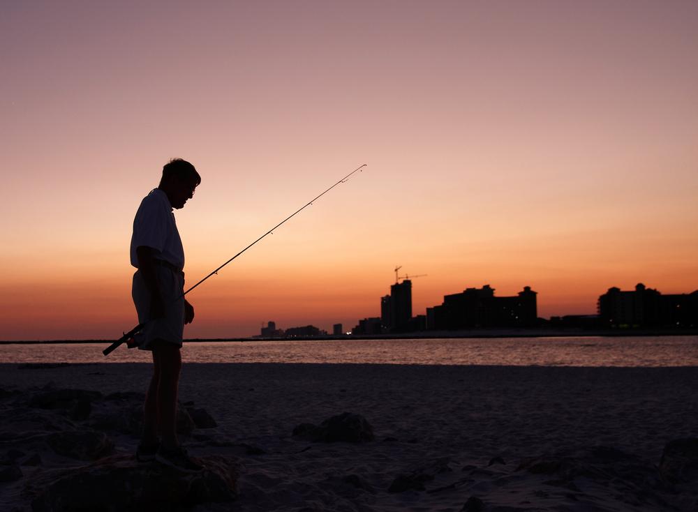 man fishing in Gulf Shores, Alabama