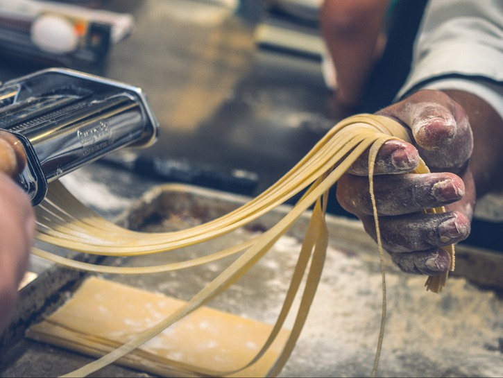 Man making pasta with his hands