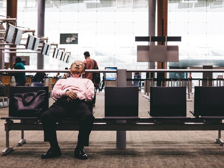 Man sleeping in airport terminal