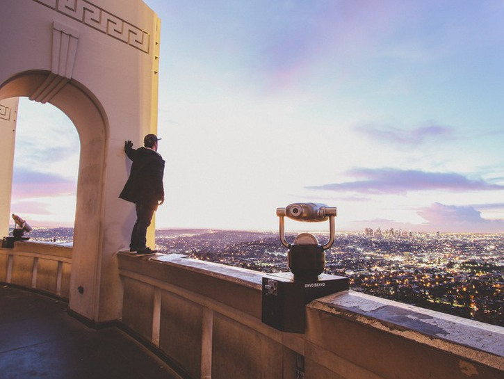 Man standing on overlook of the Griffith Observatory, Los Angeles