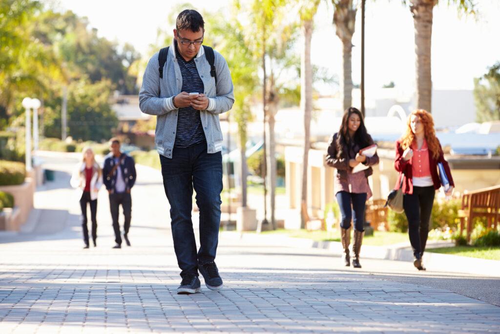 Man texting and walking