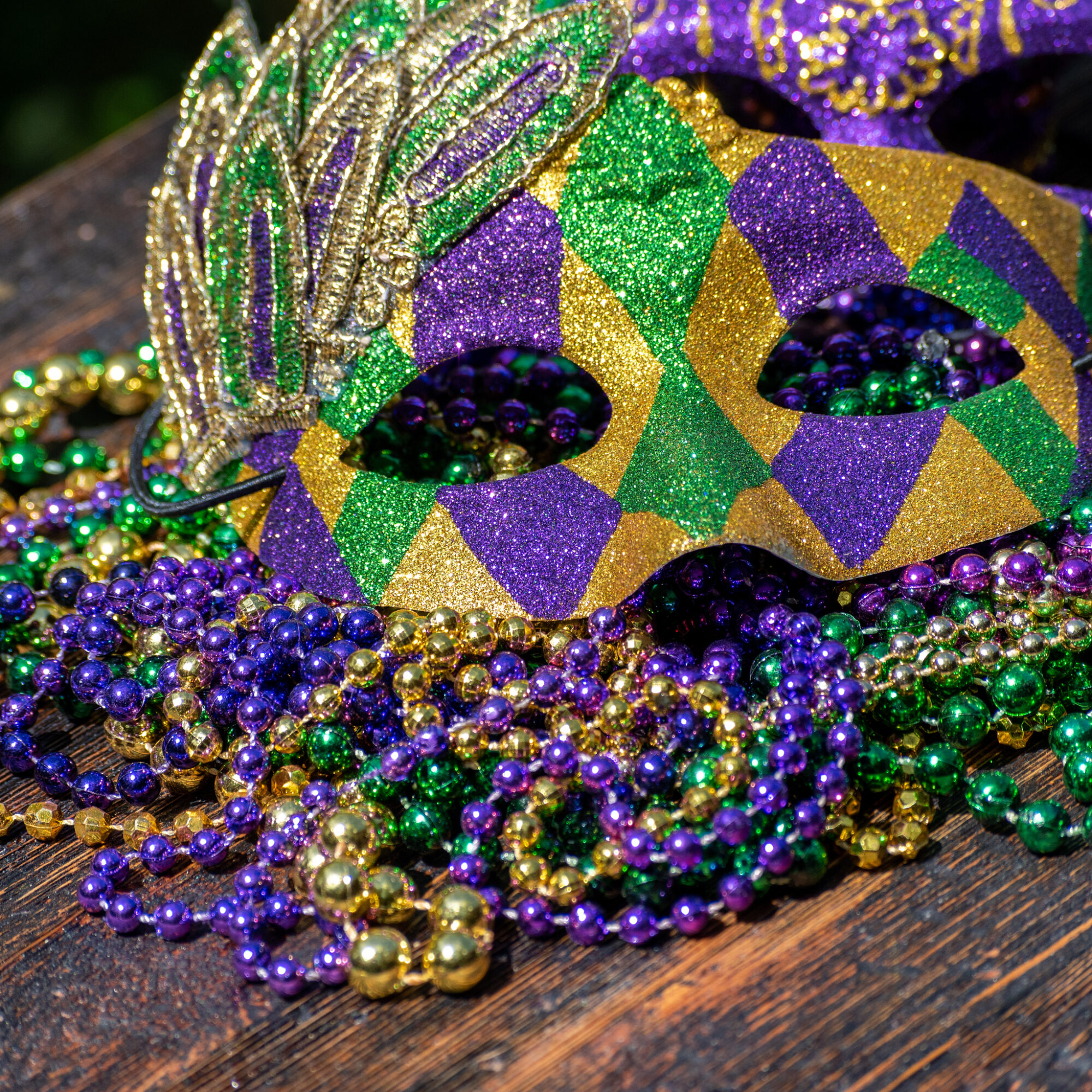 Mardi Gras mask and beads.
