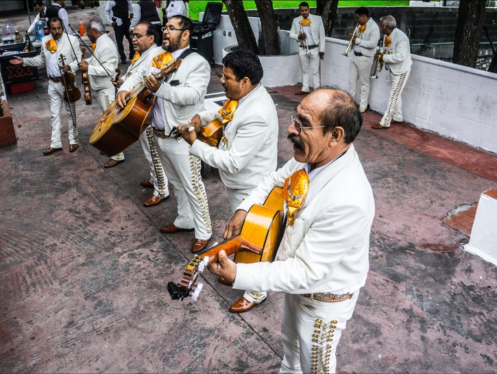 Mariachi band playing in outdoor square, Mexico