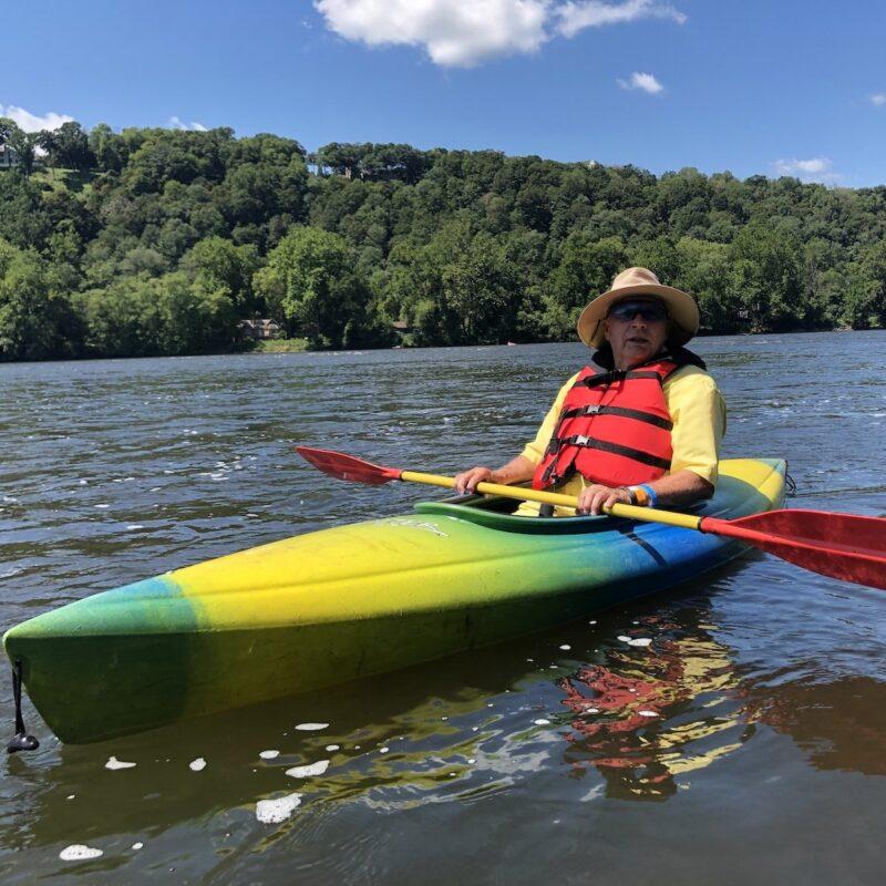 Mature man kayaking.