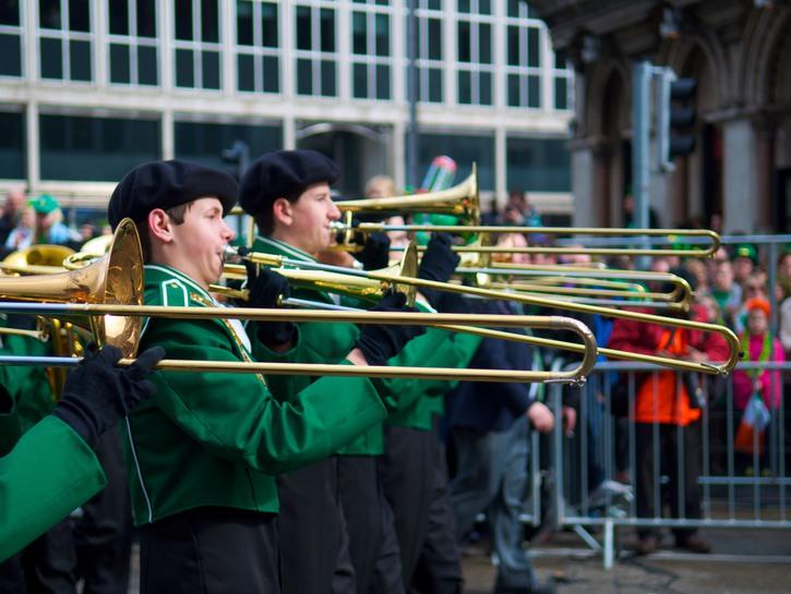 Men in green coats play trombones, St. Patrick's Day Parade, Dublin.