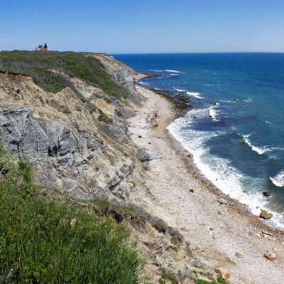 Mohegan Bluffs on Block Island, with the Southeast Light in the distance.