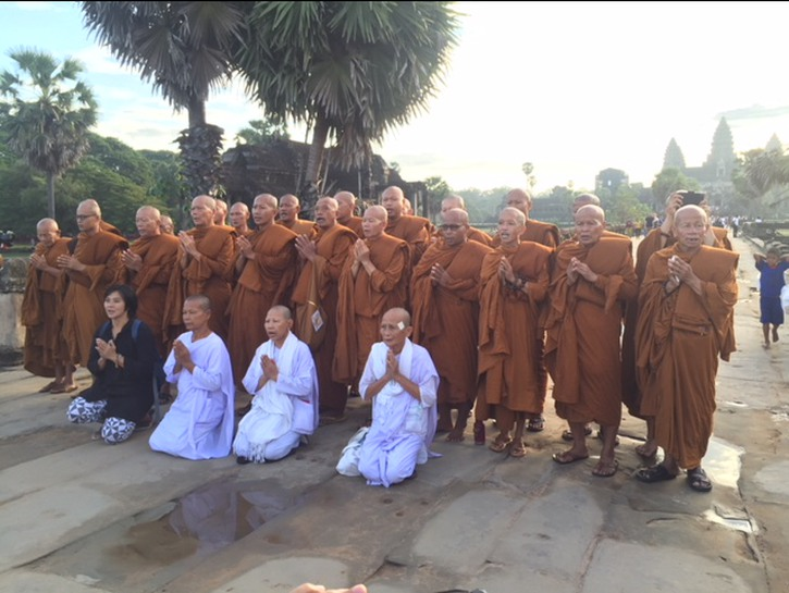 Monks in Thailand praying outside monastery
