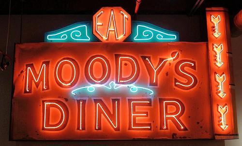 Moody's Diner lit neon sign.