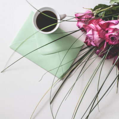 Mother's Day cup of coffee, card, and flowers