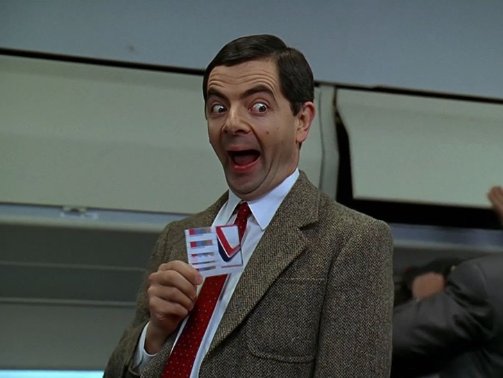 Mr. Bean with a plane ticket