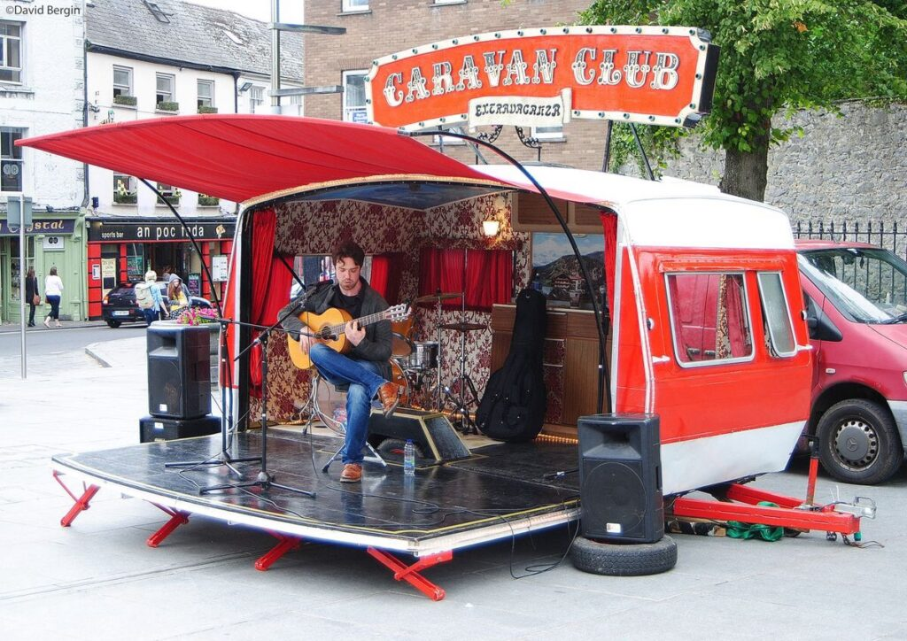 Musical performance on fold out stage attached to trailer at Kilkenny Arts Festival.