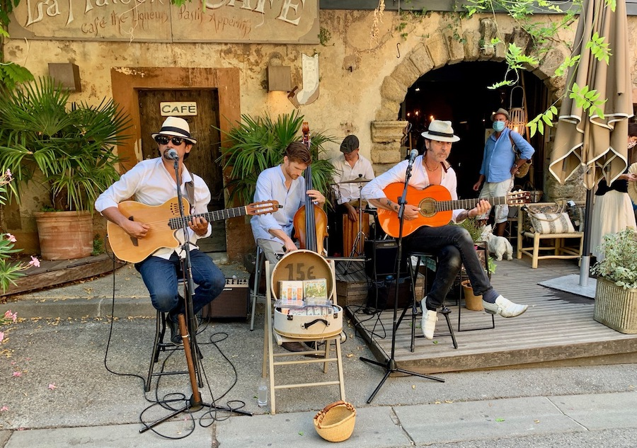 Musicians performing outdoors in France.