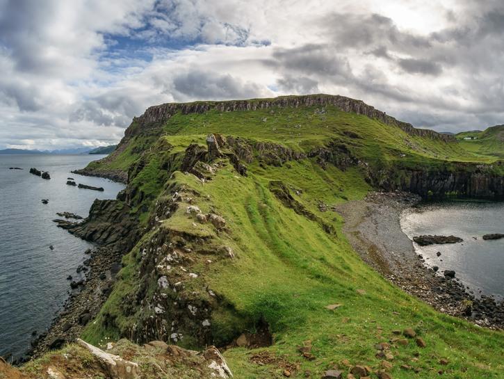 Narrow, rocky peninsula between two lakes, Isle of Skye